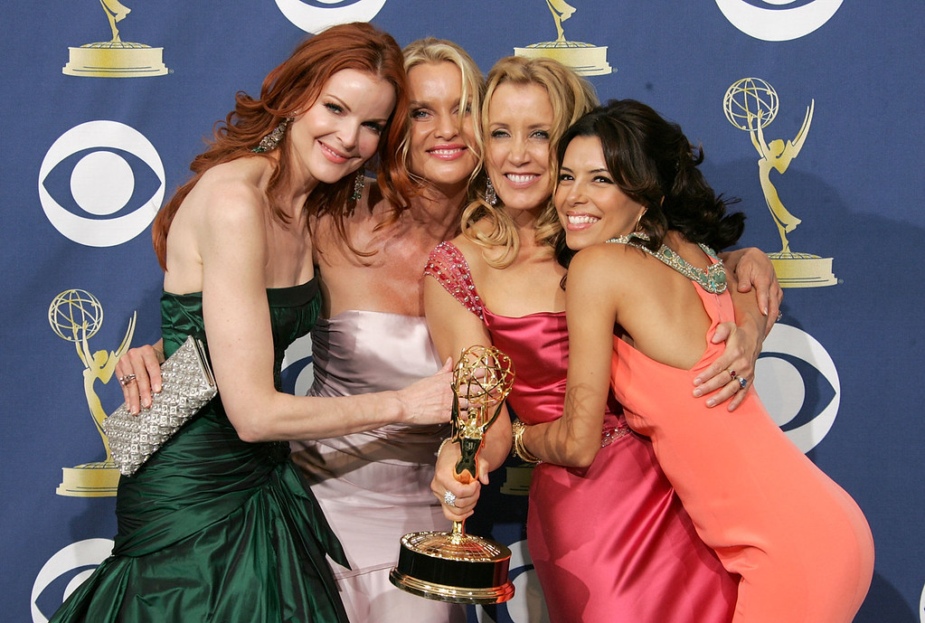 . Actresses Marcia Cross, Nicollette Sheridan, winner of Lead Actress in a Comedy Series Felicity Huffman and actress Eva Longoria poses in the press room at the 57th Annual Emmy Awards held at the Shrine Auditorium on September 18, 2005 in Los Angeles, California.  (Photo by Kevin Winter/Getty Images)