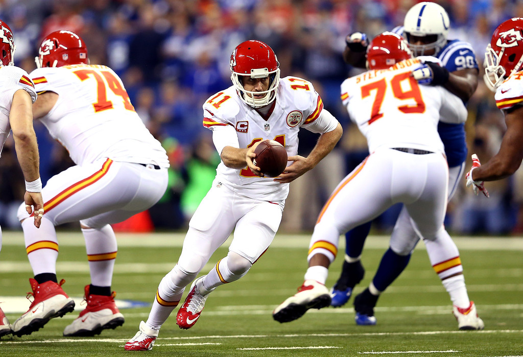 . INDIANAPOLIS, IN - JANUARY 04: Quarterback Alex Smith #11 of the Kansas City Chiefs drops back against the Indianapolis Colts during a Wild Card Playoff game at Lucas Oil Stadium on January 4, 2014 in Indianapolis, Indiana.  (Photo by Andy Lyons/Getty Images)