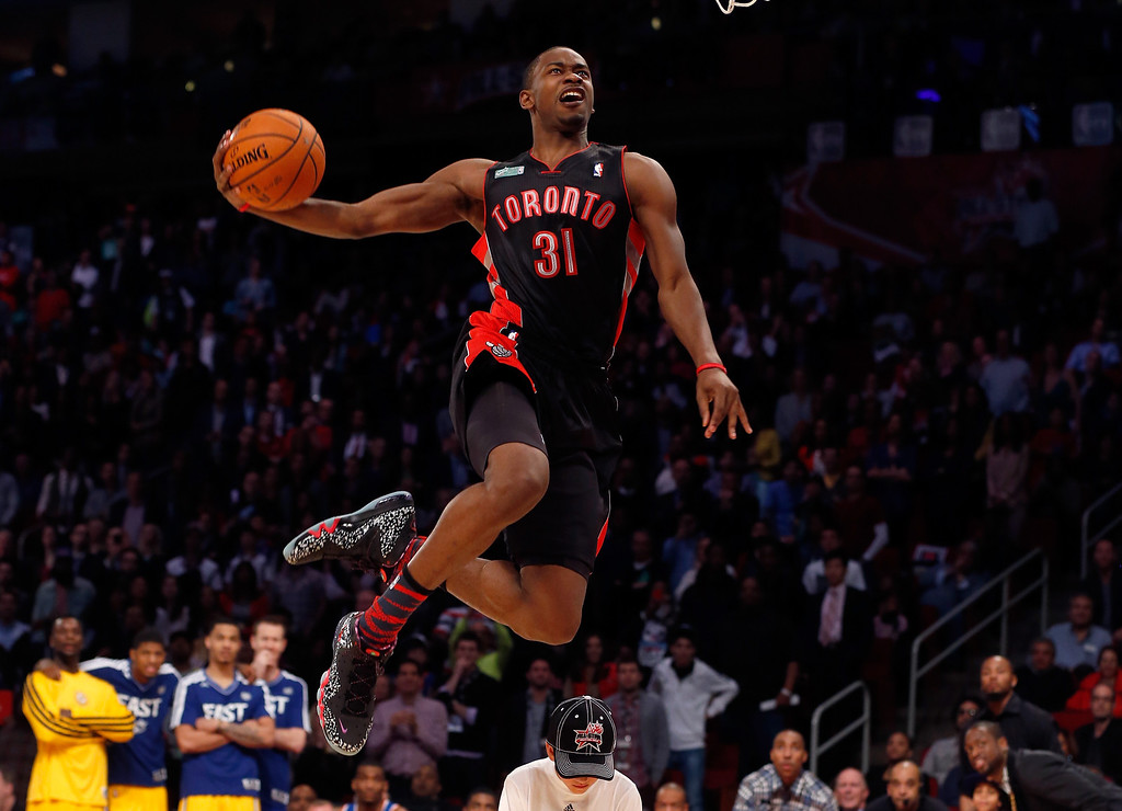 . HOUSTON, TX - FEBRUARY 16:  Terrence Ross of the Toronto Raptors jumps over a ball kid in his final dunk during the Sprite Slam Dunk Contest part of 2013 NBA All-Star Weekend at the Toyota Center on February 16, 2013 in Houston, Texas.  (Photo by Scott Halleran/Getty Images)