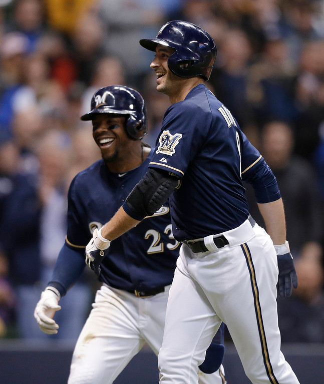 . Milwaukee Brewers\' Ryan Braun, right, and Rickie Weeks smile after Braun\'s two-run home run against the Colorado Rockies during the third inning of a baseball game Tuesday, April 2, 2013, in Milwaukee. (AP Photo/Jeffrey Phelps)