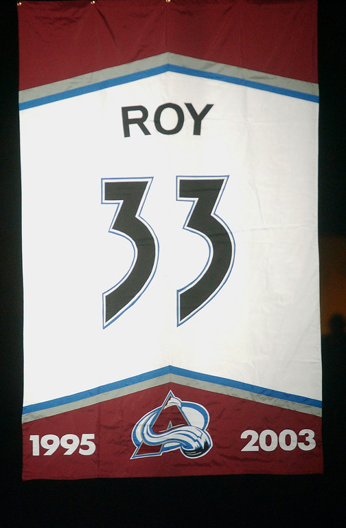. Former Denver Avalanche goalie Patrick Roy\'s Jersey is raised to the rafters during pregame ceremonies at the Pepsi Center on Tuesday night Oct. 28th, 2003.                              (Steve Dykes/The Denver Post)