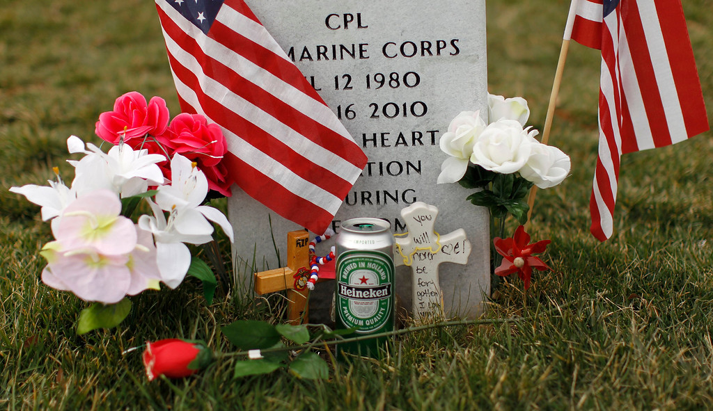 . A beer can is seen in front of a headstone in Section 60 at Arlington National Cemetery in Virginia, March 13, 2013. Section 60 contains graves of soldiers from the wars in Iraq and Afghanistan. Picture taken March 13, 2013. REUTERS/Kevin Lamarque