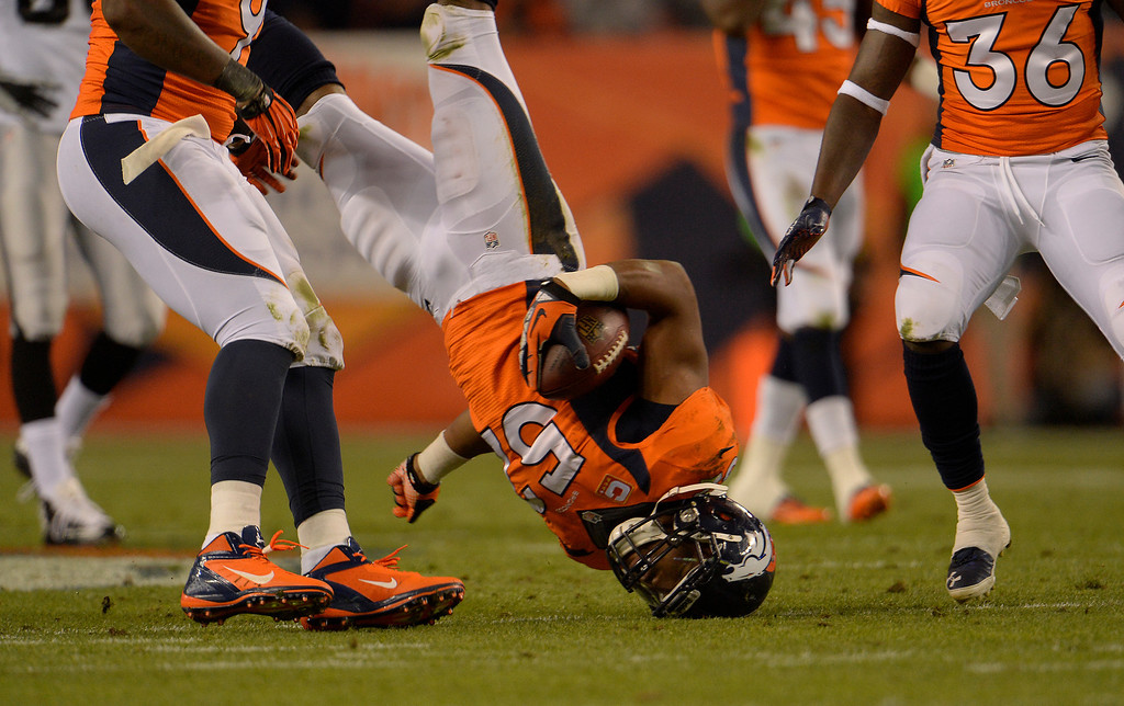 . DENVER, CO - SEPTEMBER 23: Denver Broncos outside linebacker Wesley Woodyard (52) falls awkwardly in the second quarter. The Denver Broncos took on the Oakland Raiders at Sports Authority Field at Mile High in Denver on September 23, 2013. (Photo by Joe Amon/The Denver Post)