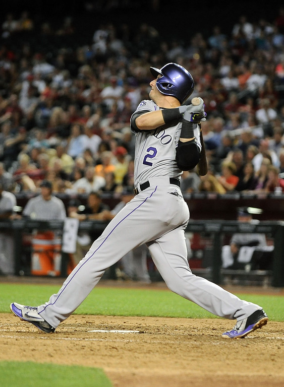 . PHOENIX, AZ - APRIL 26:  Troy Tulowitzki #2 of the Colorado Rockies hits a three-run double against the Arizona Diamondbacks in the fifth inning at Chase Field on April 26, 2013 in Phoenix, Arizona.  (Photo by Jennifer Stewart/Getty Images)