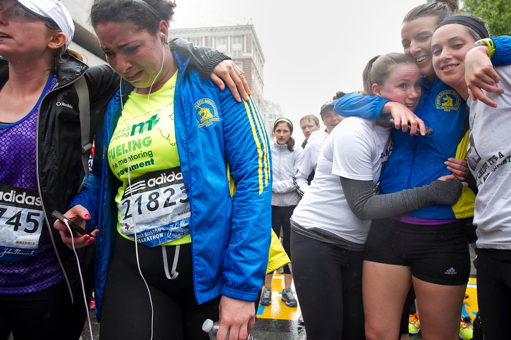 """. Runners cross the finish line after completing the final mile of the Boston Marathon course during \""""#onerun\"""" in Boston, Massachusetts, May 25, 2013. T   REUTERS/Dominick Reuter"""