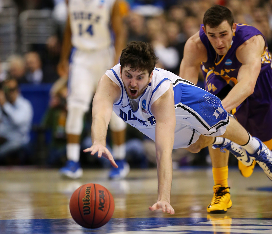 . Ryan Kelly #34 of the Duke Blue Devils dives for a loose ball in the second half while taking on the Albany Great Danes during the second round of the 2013 NCAA Men\'s Basketball Tournament on March 22, 2013 at Wells Fargo Center in Philadelphia, Pennsylvania.  (Photo by Elsa/Getty Images)