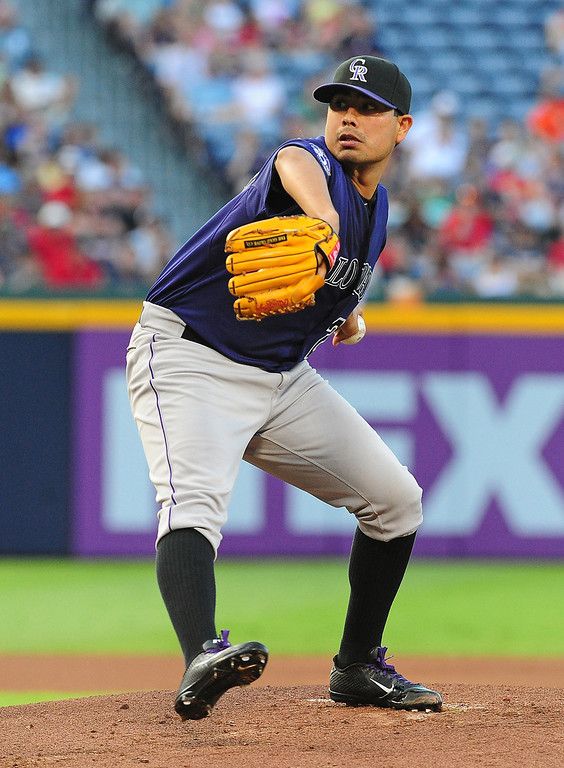 . Jorge De La Rosa #29 of the Colorado Rockies pitches against the Atlanta Braves at Turner Field on July 29, 2013 in Atlanta, Georgia. (Photo by Scott Cunningham/Getty Images)