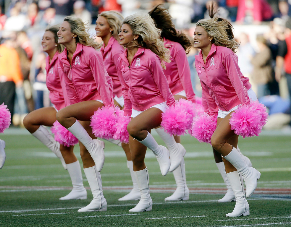 . New England Patriots cheerleaders, wearing pink to call attention to breast cancer awareness month, perform before an NFL football game between the Patriots and the New Orleans Saints Sunday, Oct.13, 2013, in Foxborough, Mass. (AP Photo/Stephan Savoia)