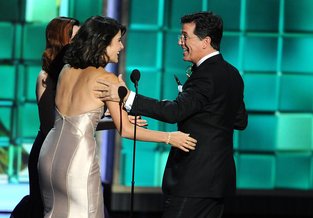 . Actresses Alyson Hannigan and Cobie Smulders present an award to Stephen Colbert onstage during the 65th Annual Primetime Emmy Awards held at Nokia Theatre L.A. Live on September 22, 2013 in Los Angeles, California.  (Photo by Kevin Winter/Getty Images)
