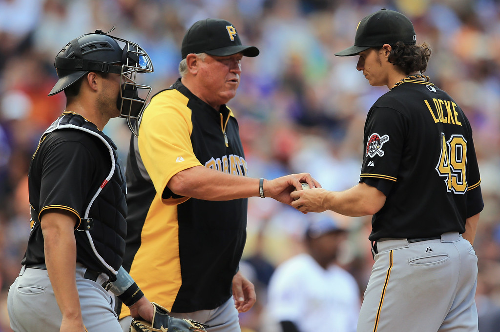 . Manager Clint Hurdle #13 of the Pittsburgh Pirates removes starting pitcher Jeff Locke #49 of the Pittsburgh Pirates from the game in the sixth inning against the Colorado Rockies at Coors Field on August 11, 2013 in Denver, Colorado. The Rockies defeated the Pirates 3-2 and swept the three game series.  (Photo by Doug Pensinger/Getty Images)