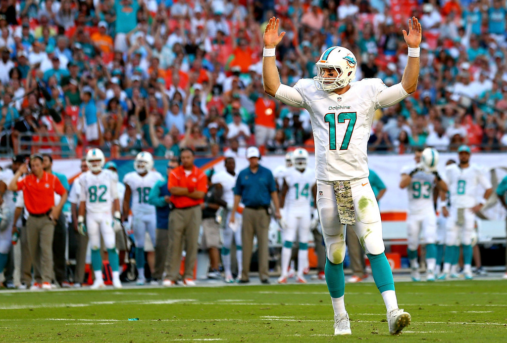 . Ryan Tannehill #17 of the Miami Dolphins celebrates after a touchdown during their game against the San Diego Chargers at Sun Life Stadium on November 17, 2013 in Miami Gardens, Florida.  (Photo by Streeter Lecka/Getty Images)
