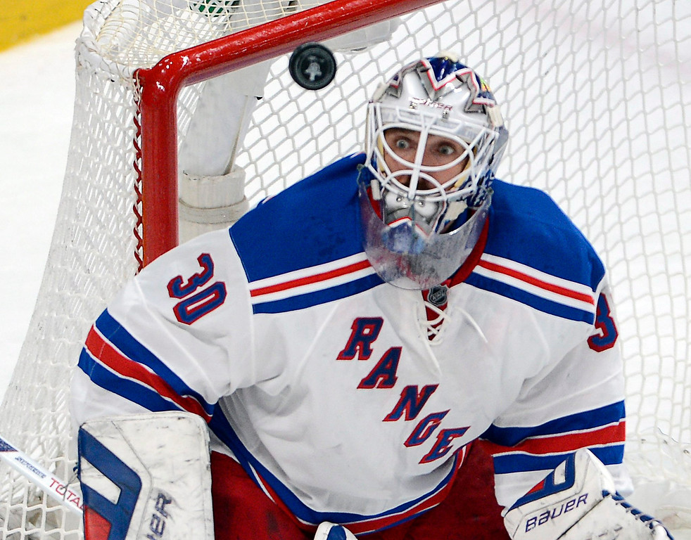 . New York Rangers goalie Henrik Lundqvist keeps his eyes on the puck during the first period against the Montreal Canadiens in Game 5 of the NHL hockey Stanley Cup playoffs Eastern Conference finals, Tuesday, May 27, 2014, in Montreal. (AP Photo/The Canadian Press, Ryan Remiorz)