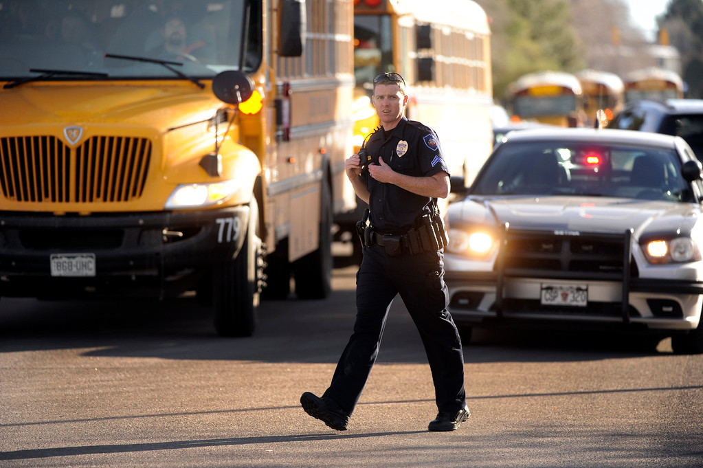 . CENTENNIAL, CO. - DECEMBER 13: Students were put onto buses to be transported away from Arapahoe High School Friday afternoon, December 13, 2013. A shooting inside the school sent hundreds of students rushing for safety. Photo By Karl Gehring/The Denver Post
