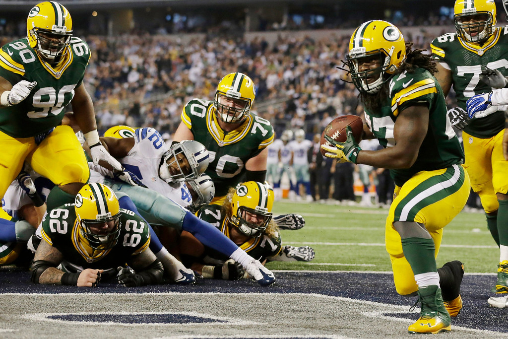 . Green Bay Packers running back Eddie Lacy (27) scores a touchdown against the Dallas Cowboys during the second half of an NFL football game, Sunday, Dec. 15, 2013, in Arlington, Texas. (AP Photo/Tony Gutierrez)