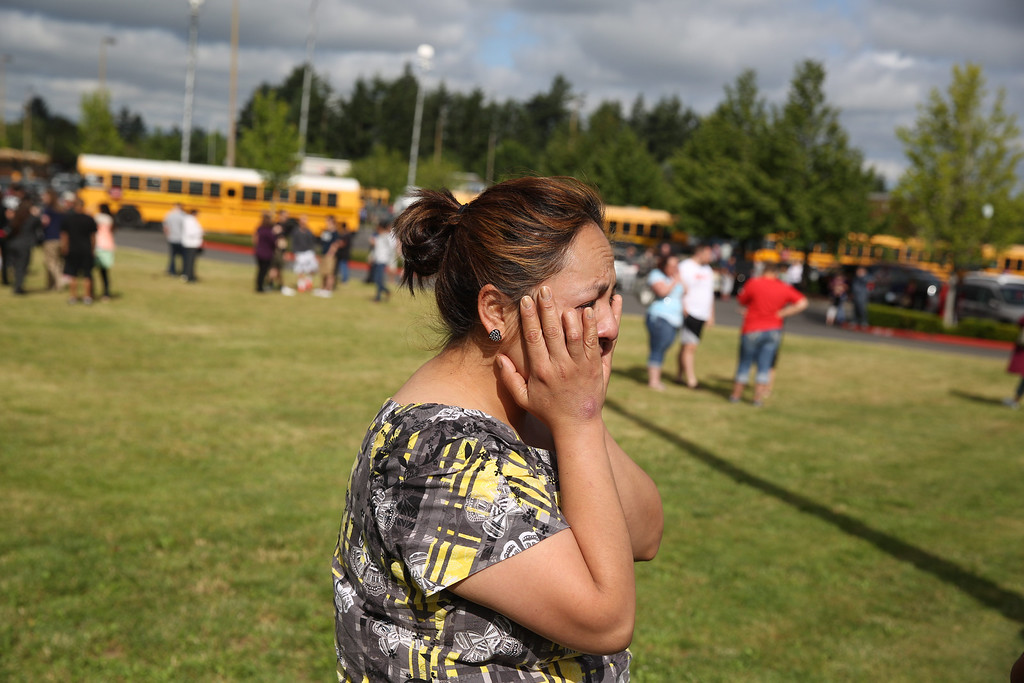 . A woman waits to hear about the safety of students after a shooting at Reynolds High School Tuesday, June 10, 2014, in Troutdale, Ore.  (AP Photo/The Oregonian, Faith Cathcart)