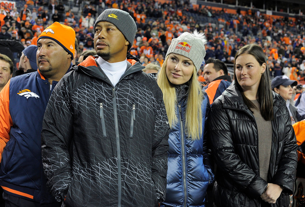 . Tiger Woods and Lindsey Vonn watch from the sidelines before the start of the game. The Denver Broncos take on the Kansas City Chiefs at Sports Authority Field at Mile High in Denver on November 17, 2013. (Photo by John Leyba/The Denver Post)