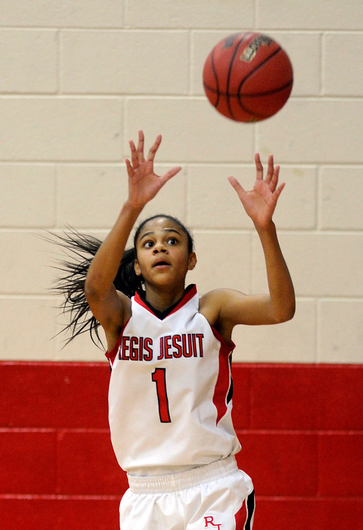 . Raiders junior guard Justine Hall took a pass on the baseline in the second half. The Regis Jesuit High School girl\'s  basketball team defeated Grandview 59-53 Saturday night, January 12, 2013. Karl Gehring/The Denver Post