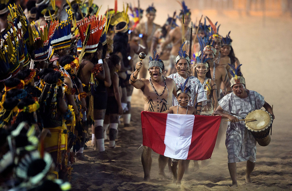. Peruvian natives parade during the opening ceremony of the International Games of Indigenous Peoples, in Cuiaba, state of Mato Grosso, on November 9, 2013. 48 Brazilian ethnic groups and indigenous representatives from 16 countries are taking part in the event which runs until November 16. AFP PHOTO / CHRISTOPHE SIMON