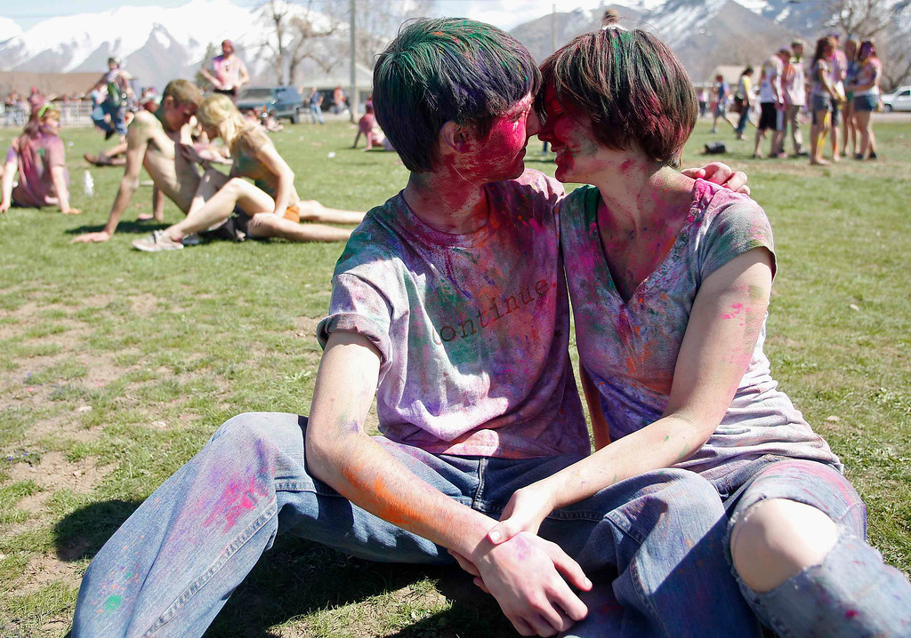 . Colin Nimer (L) and his girlfriend Emily Nelson kiss during the Holi Festival of Colors at the Sri Sri Radha Krishna Temple in Spanish Fork, Utah, March 30, 2013. REUTERS/Jim Urquhart