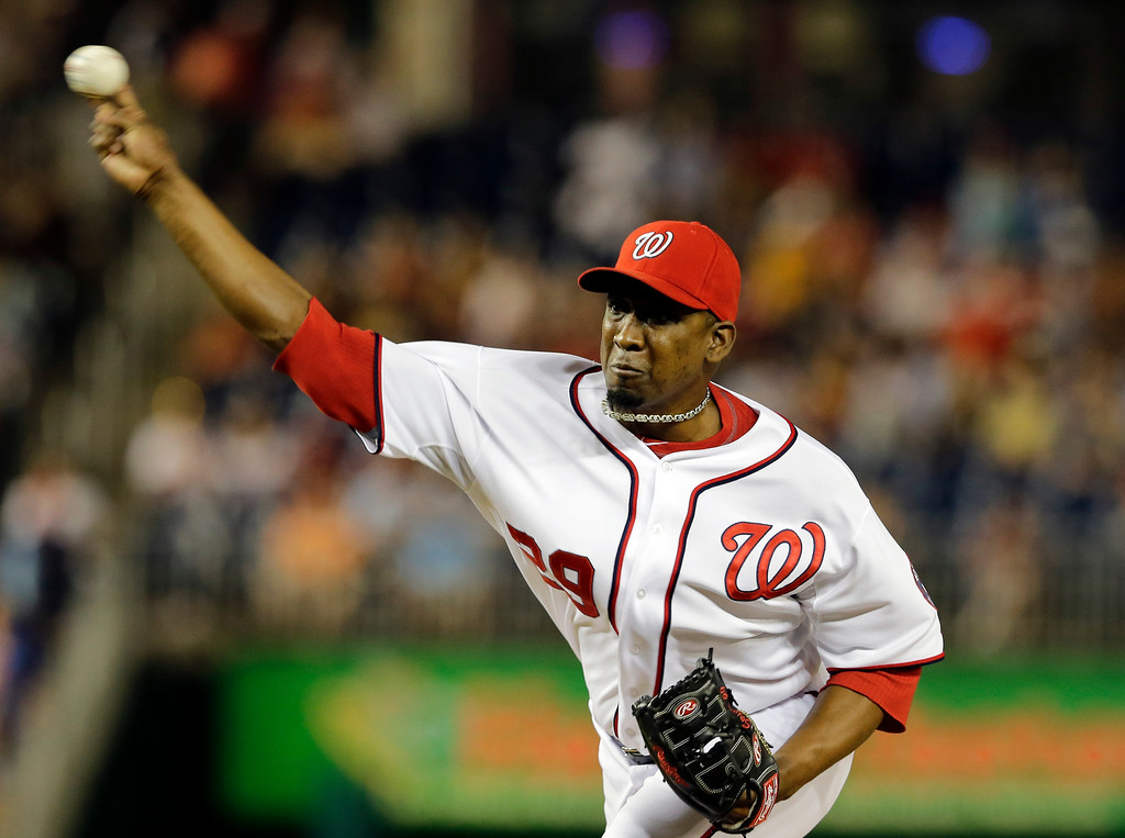 . Washington Nationals relief pitcher Rafael Soriano throws during the ninth inning of a baseball game against the Colorado Rockies at Nationals Park, Thursday, June 20, 2013, in Washington. The Nationals won 5-1. (AP Photo/Alex Brandon)