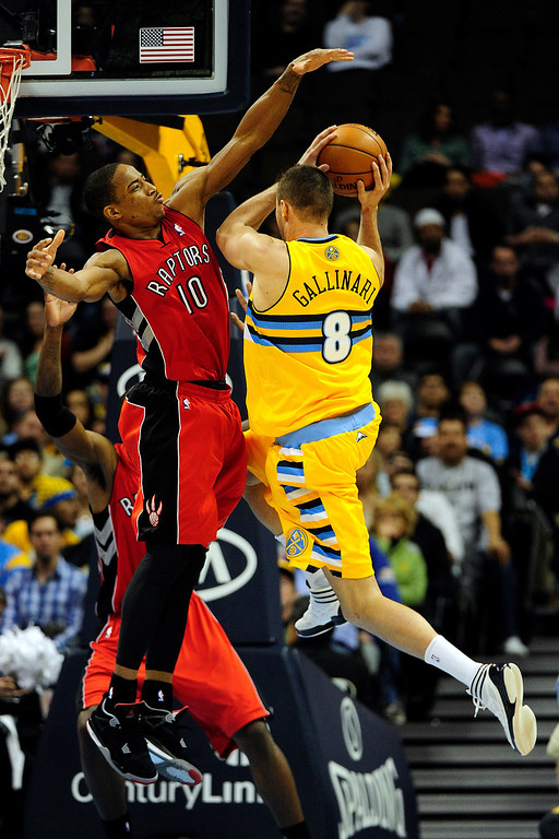 . Denver Nuggets small forward Danilo Gallinari (8) drives on Toronto Raptors shooting guard DeMar DeRozan (10) during the second half of the Nuggets\' 113-110 win at the Pepsi Center on Monday, December 3, 2012. AAron Ontiveroz, The Denver Post