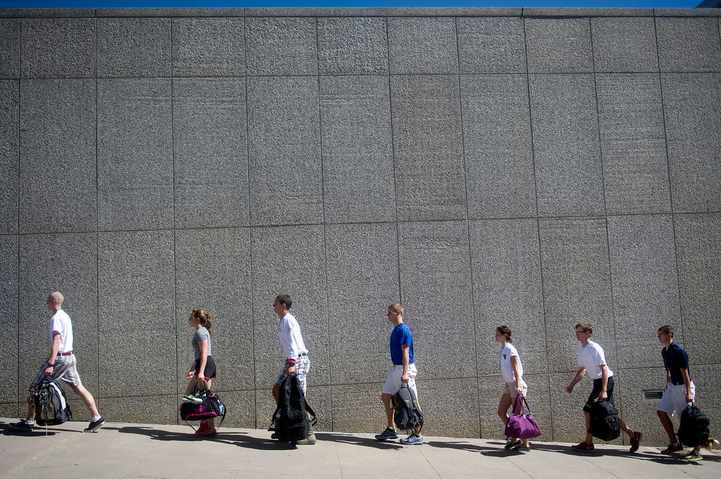 . COLORADO SPRINGS, CO. - JUNE 27: Basic Cadet Trainees hustle in line to their dorms at the Air Force Academy for inprocessing on June 27, 2013. (Photo By Grant Hindsley/The Denver Post)