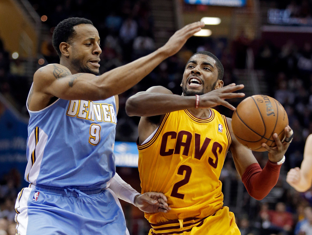 . Cleveland Cavaliers\' Kyrie Irving (2) drives the lane on Denver Nuggets\' Andre Iguodala (9) during the fourth quarter of an NBA basketball game Saturday, Feb. 9, 2013, in Cleveland. The Nuggets won 111-103. (AP Photo/Mark Duncan)