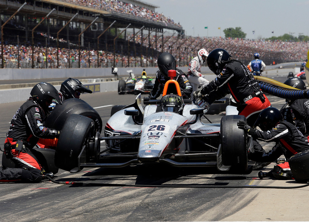 . Kurt Busch pits during the 98th running of the Indianapolis 500 IndyCar auto race at the Indianapolis Motor Speedway in Indianapolis, Sunday, May 25, 2014. (AP Photo/R Brent Smith)