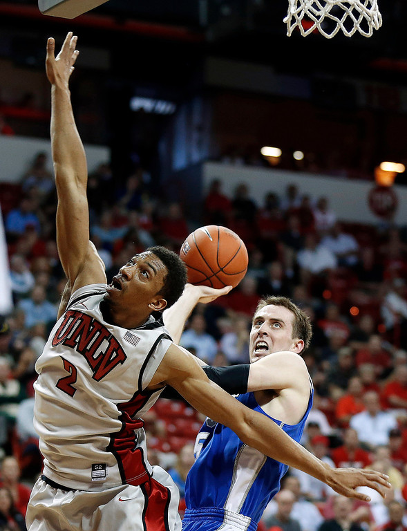 . UNLV\'s Khem Birch (2) tries to block a shot from Air Force\'s Mike Fitzgerald during the first half of a Mountain West Conference tournament NCAA college basketball game on Wednesday, March 13, 2013, in Las Vegas. (AP Photo/Isaac Brekken)