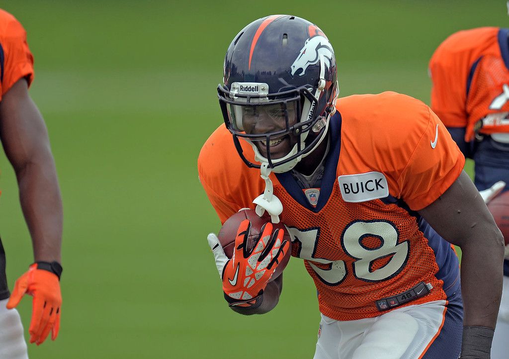 . Denver Broncos running back Montee Ball (38) smiles as he prepares for drills during practice September 1, 2013 at Dove Valley. (Photo by John Leyba/The Denver Post)