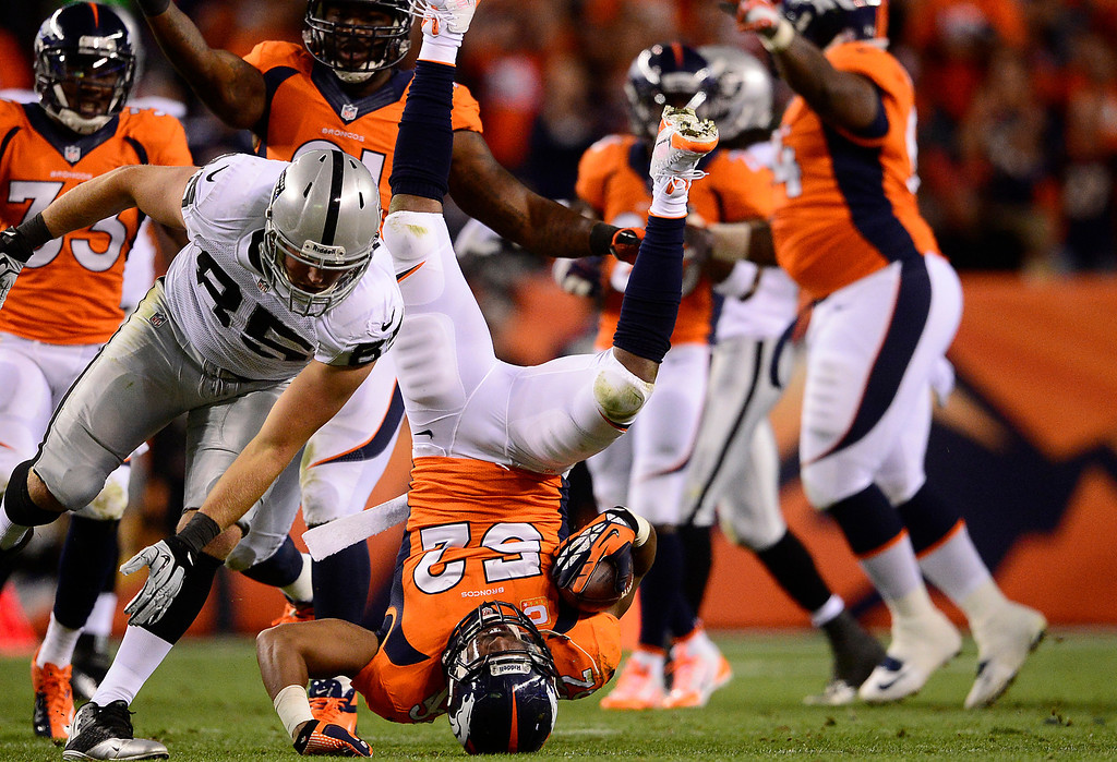 . DENVER, CO - SEPTEMBER 23: Denver Broncos outside linebacker Wesley Woodyard (52) falls over after recovering a fumbled that was called back in the second quarter. The Denver Broncos took on the Oakland Raiders at Sports Authority Field at Mile High in Denver on September 23, 2013. (Photo by AAron Ontiveroz/The Denver Post)