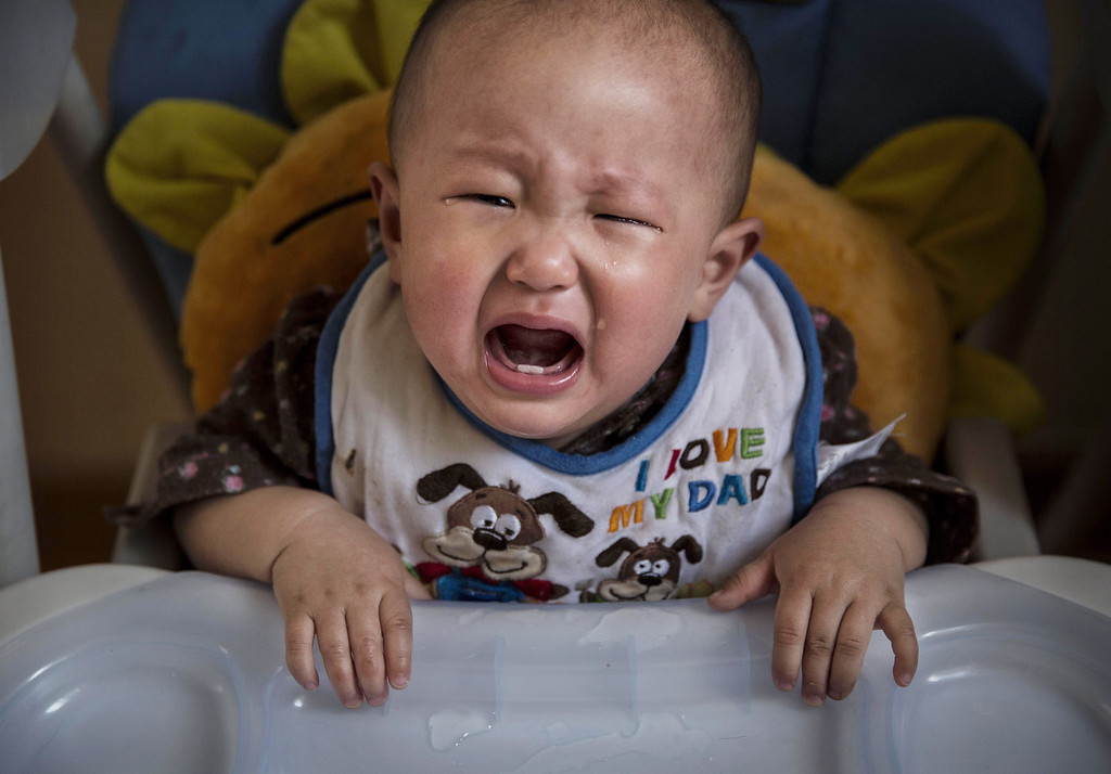 . A young Chinese cries as she waits for feeding at a foster care center on April 2, 2014 in Beijing, China.  (Photo by Kevin Frayer/Getty Images)