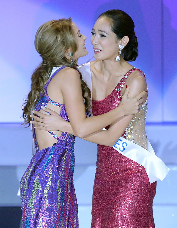 . Nathalie den Dekker (L) of the Netherlands is congratulated by Bea Rose Santiago of the Philippines after being chosen runner-up of the Miss International Beauty Pageant in Tokyo on December 17, 2013. The 23-year-old from the Philippines won the crown for this year\'s Miss International on Tuesday. TORU YAMANAKA/AFP/Getty Images