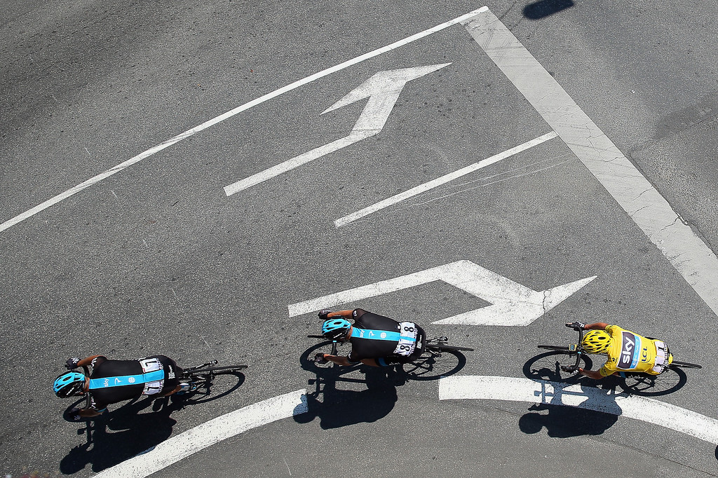 . SKY Procycling riders Kanstanstin Siutsou of Belarus, Ian Stannard of Great Britain lead yellow jersey holder Chris Froome of Greta Britain during stage ten of the 2013 Tour de France, a 197KM road stage from St-Gildas-des-Bois to Saint Malo, on July 9, 2013 in St Malo, France.  (Photo by Bryn Lennon/Getty Images)