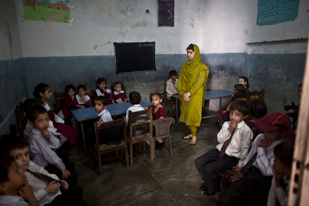 . Pakistani school children sit in their classroom during a special class to commemorate the anniversary of Malala Yousufzai\'s shooting by Taliban, at a school in Rawalpindi, Pakistan, Wednesday, Oct. 9, 2013. One year after a Taliban bullet tried to silence Malala\'s demand for girls\' education, she has published a book and is a contender for the Nobel Peace Prize. But the militants threaten to kill her should she dare return home to Pakistan, and the principal at her old school says that as Malala\'s fame has grown, so has fear in her classrooms. (AP Photo/Muhammed Muheisen)