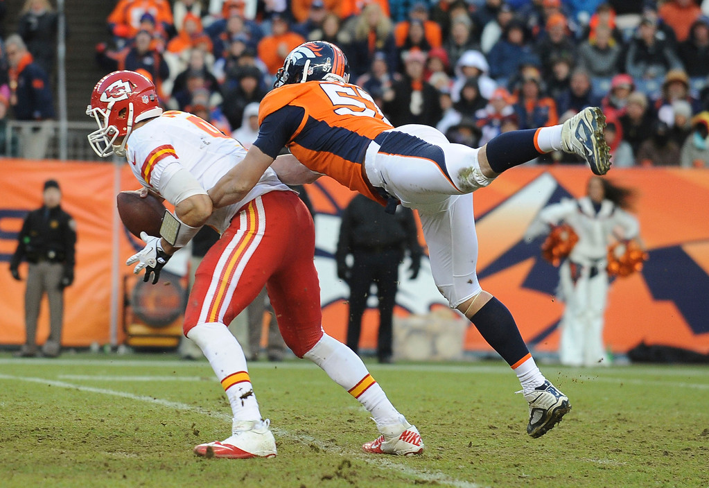 . Denver Broncos linebacker Keith Brooking sacks Kansas City quarterback Brady Quinn in the third quarter Sunday at Sports Authority Field. Steve Nehf, The Denver Post