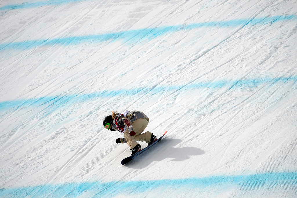 . ROSA KHUTOR, RUSSIA - FEBRUARY 09: Gold medalist Jamie Anderson, of the United States, tucks during the women\'s snowboard slopestyle final. Sochi 2014 Winter Olympics at the Rosa Khutor Etreme Park on Sunday, February 9, 2014. (Photo by AAron Ontiveroz/The Denver Post)