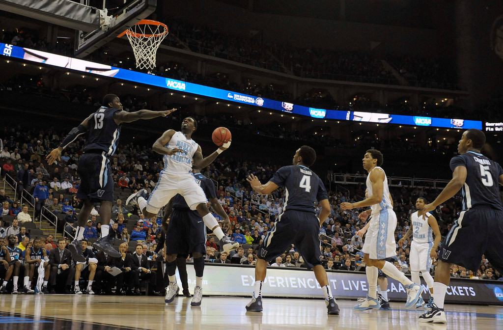 . North Carolina Tar Heels guard P.J. Hairston shoots against Villanova Wildcats forward Mouphtaou Yarou during the first half of the second round of the NCAA men\'s basketball tournament at the Sprint Center in Kansas City, Missouri, March 22, 2013. REUTERS/Dave Kaup