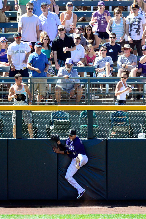 . Colorado Rockies left fielder Carlos Gonzalez (5) makes a bases-loaded, inning-ending catch on a ball hit by San Diego Padres right fielder Will Venable (25) on June 9, 2013, in Denver.  (Photo by AAron Ontiveroz/The Denver Post)