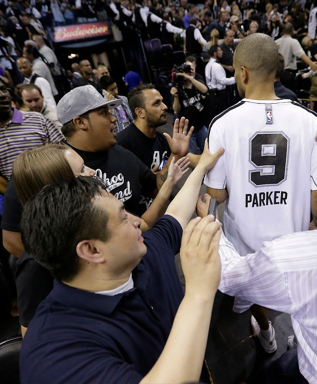 . San Antonio Spurs\' Tony Parker (9) leaves the floor after Game 5 of the NBA Finals basketball series against the Miami Heat, Sunday, June 16, 2013, in San Antonio. The Spurs won 114-104. (AP Photo/Eric Gay)