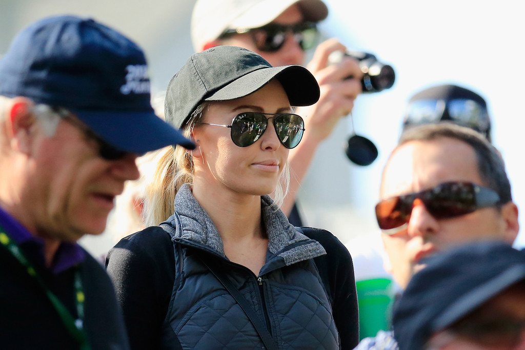 . Paulina Gretzky looks on as Dustin Johnson of the United States plays in the 2014 Par Three Contest prior to the start of the 2014 Masters Tournament at Augusta National Golf Club on April 9, 2014 in Augusta, Georgia.  (Photo by Rob Carr/Getty Images)