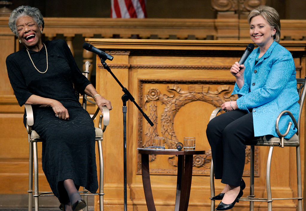 . In this April 18, 2008 file photo, then U.S. Sen. Hillary Rodham Clinton, D-N.Y., right, speaks as poet Maya Angelou reacts during a campaign stop at Wake Forest University in Winston-Salem, N.C. (AP Photo/Chuck Burton, File)