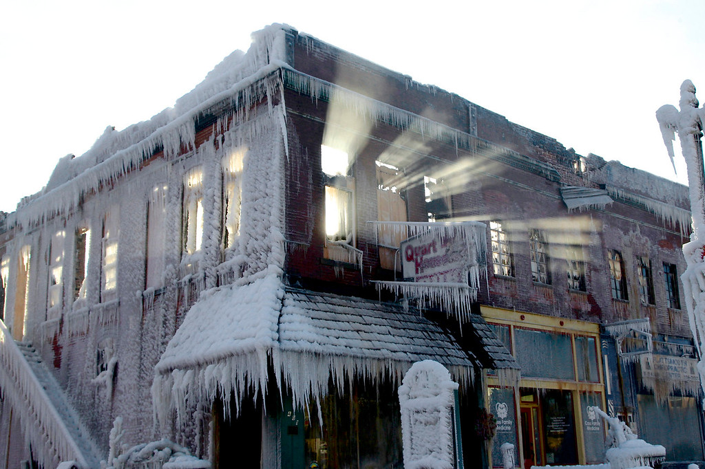 . Sunlight streams through the windows of a building which caught on fire in Plattsmouth, Neb., Friday, Jan. 3, 2014, and the water sprayed on it by fire fighters froze. Much of the American northeast and the midwest are suffering from sub-freezing temperatures. (AP Photo/Nati Harnik)
