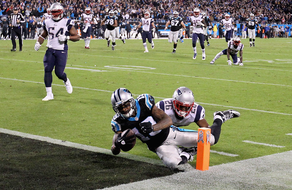 . Logan Ryan #26 of the New England Patriots dives after Ted Ginn #19 of the Carolina Panthers as he scores a touchdown late in the fourth quarter to give the Panthers a 24-20 lead during their game at Bank of America Stadium on November 18, 2013 in Charlotte, North Carolina.  (Photo by Streeter Lecka/Getty Images)