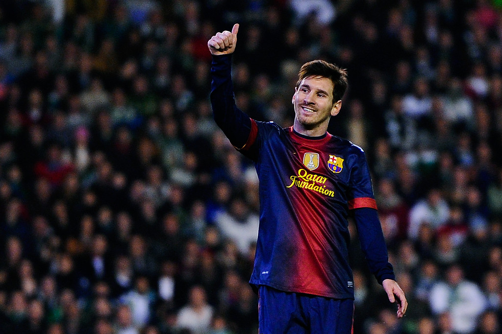 . SEVILLE, SPAIN - DECEMBER 09:  Lionel Messi of FC Barcelona gives his thumbs up during the La Liga match between Real Betis Balompie and FC Barcelona at Estadio Benito Villamarin on December 9, 2012 in Seville, Spain.  (Photo by David Ramos/Getty Images)