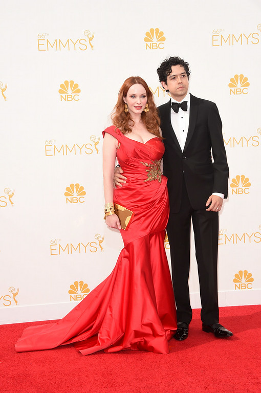 . Actress Christina Hendricks and Geoffrey Arend attend the 66th Annual Primetime Emmy Awards held at Nokia Theatre L.A. Live on August 25, 2014 in Los Angeles, California.  (Photo by Jason Merritt/Getty Images)