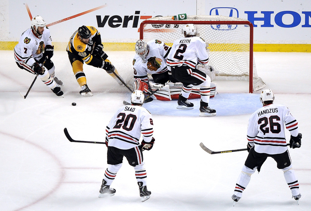 . Corey Crawford #50 of the Chicago Blackhawks tends goal against Rich Peverley #49 of the Boston Bruins in Game Three of the 2013 NHL Stanley Cup Final at TD Garden on June 17, 2013 in Boston, Massachusetts.  (Photo by Harry How/Getty Images)
