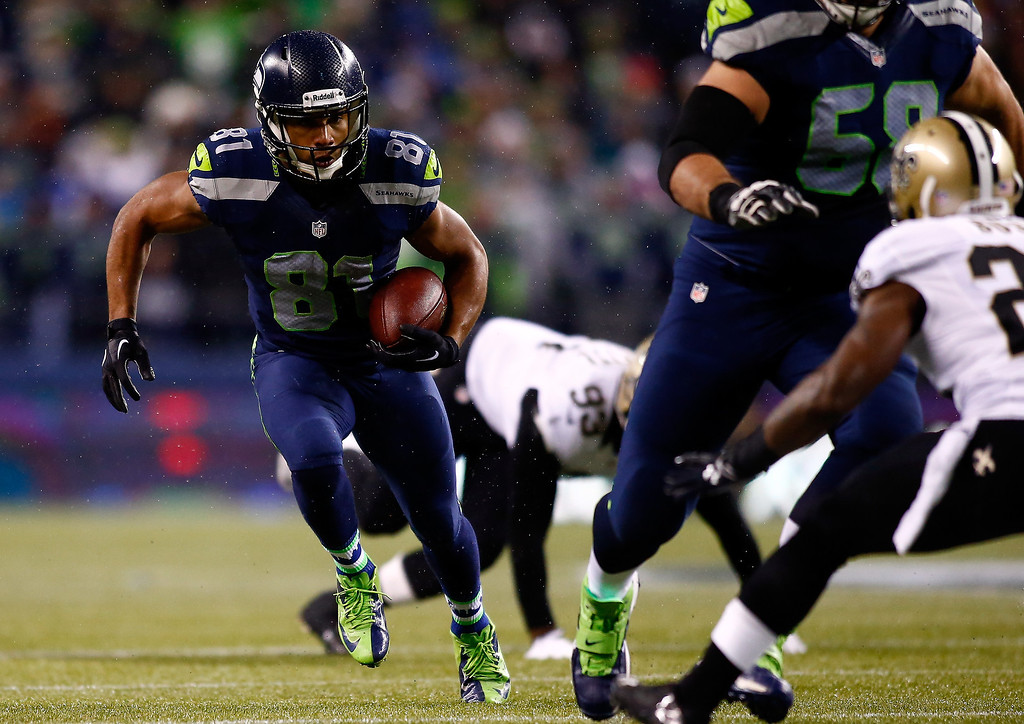 . Wide receiver Golden Tate #81 of the Seattle Seahawks runs with the ball against the New Orleans Saints during a game at CenturyLink Field on December 2, 2013 in Seattle, Washington.  (Photo by Jonathan Ferrey/Getty Images)