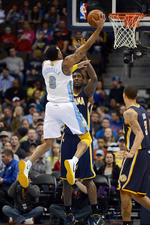 . DENVER, CO. - JANUARY 28: Denver Nuggets shooting guard Andre Iguodala (9) goes up for an easy layup past Indiana Pacers center Roy Hibbert (55) during the first quarter  January 28, 2013 at Pepsi Center. The Denver Nuggets host  the Indiana Pacers in NBA Action. (Photo By John Leyba / The Denver Post)