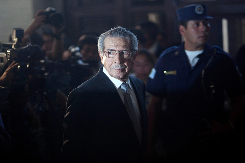 . In this Jan. 26, 2012 file photo, Guatemala\'s former dictator Efrain Rios Montt (1982-1983), who faces genocide charges, returns from a break in court in Guatemala City.  Ten months after the historic day when a judge ruled that the former dictator Rios Montt was indicted for genocide, the trial has not yet started due to legal maneuvering by military lawyers, delaying the process. (AP Photo/Rodrigo Abd, File)